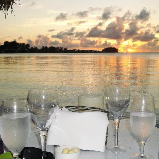 Romantic sunset dining on the beach at Breezes restaurant in Bermuda