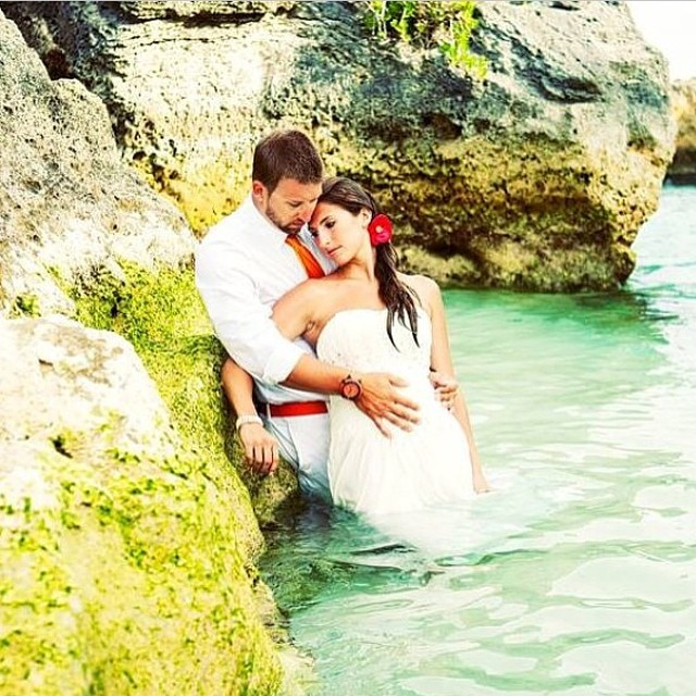 Romantic couple wading in Blue Bermuda water